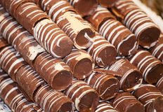 Delicious rolled milk chocolate cakes in patisserie Stock Images