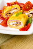 Delicious rolls omelette with tomato, ham and cheese cream Royalty Free Stock Photos