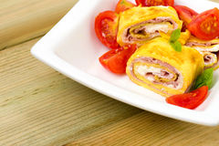 Delicious rolls omelette with tomato, ham and cheese cream Royalty Free Stock Images