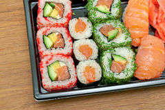 Delicious rolls and sushi on a cutting board close-up Royalty Free Stock Image