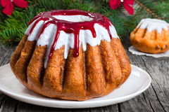 Delicious rum bundt christmas cake with colorful sugar glaze Royalty Free Stock Image