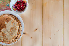 Delicious rustic fragrant pancakes with lingonberries. Top view. Flat lay Royalty Free Stock Images