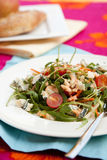 Delicious salad. Delicious healthy salad with green, tomatoes, blue cheese and pinenuts stock image