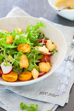 Delicious salad. Healthy and delicious salad with rocket, halloumi and tomatoes stock photo