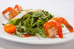 A delicious salad with arugula, cherry tomatoes and shrimps Stock Images