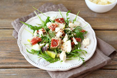Delicious salad with arugula, sliced ​​pears and figs Royalty Free Stock Photo