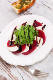 Delicious salad with beet, goat cheese and arugula. Royalty Free Stock Photography