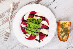 Delicious salad with beet, goat cheese and arugula. Royalty Free Stock Photo