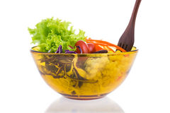 Delicious salad on a bowl with wooden fork  isolated over white Stock Photos