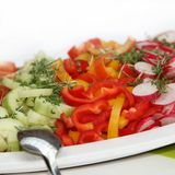 Delicious salad of cucumbers, peppers and radishes Royalty Free Stock Photo
