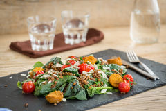 Delicious salad with falafels, lentils and baked tomato Royalty Free Stock Image