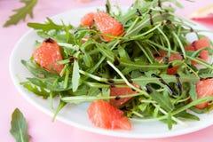 Delicious salad of fresh arugula and grapefruit Stock Photography
