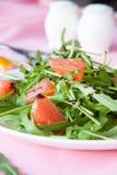Delicious salad of fresh greens and grapefruit. Closeup stock image