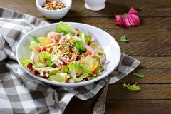 Delicious salad with fruit on a plate Stock Photography