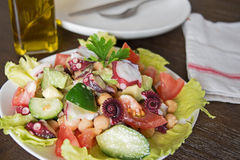 Delicious salad with Octopus and vegetables Royalty Free Stock Photography