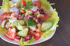 Delicious salad with Octopus and vegetables Stock Photos