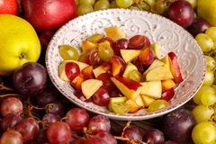 Delicious salad in a plate of fruit on a wooden table. stock image