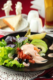 Delicious salad with shrimp, avocado, tomatoes, black olives and rosette sauce Royalty Free Stock Images