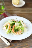 Delicious salad with shrimps, lettuce and cheese on a plate Royalty Free Stock Photography