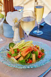 Delicious salad with smoked salmon and prawns Royalty Free Stock Image