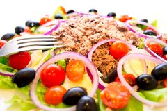 Delicious salad with tuna, tomatoes, eggs, olives Royalty Free Stock Photography