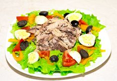 Delicious salad with tuna, tomatoes, eggs, olives Stock Images
