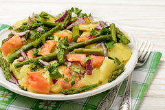 Delicious salad wit green asparagus, smoked salmon and potatoes. Stock Photo