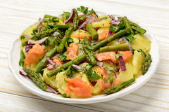 Delicious salad wit green asparagus, smoked salmon and potatoes. Royalty Free Stock Images