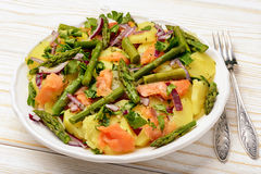 Delicious salad wit green asparagus, smoked salmon and potatoes. Stock Photos