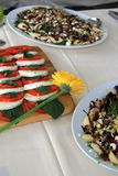 Delicious salads at catered party. Array of delicious salads on serving platters at catered party Royalty Free Stock Image