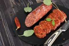 Delicious salami with basil , selective focus royalty free stock image