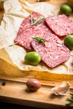 Delicious salami with olives, spices and rosemary Stock Photo