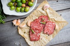 Delicious salami with olives, spices and rosemary Stock Images