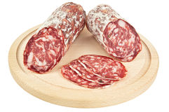 Delicious salami on wooden plank Stock Image