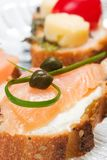 Delicious salmon canape. Closeup of smoked salmon with capers canape ready to eat Royalty Free Stock Images