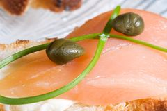 Delicious salmon canape. Closeup of smoked salmon with capers canape ready to eat Stock Photos