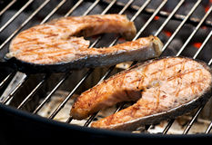 Delicious salmon cutlet steaks on the grill Stock Images