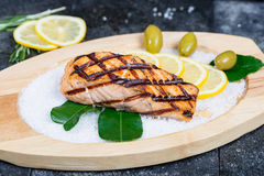 Delicious salmon fillet grilled served on a wooden Stock Photography
