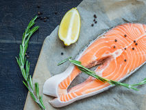 Delicious Salmon with Lemons and Pepper Stock Photos