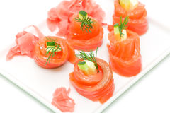 Salmon rolls with cheese and cucumber on white background Stock Image