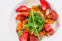 Delicious salmon salad with seaweed and strawberry. Royalty Free Stock Image