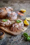 Salmon spread with cream cheese and onion on whole grain bread slices Stock Images