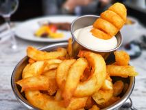 Curly fries with mayo Royalty Free Stock Images