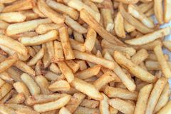 Delicious salty french fries on a fair stall Royalty Free Stock Photo