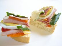 Delicious sandwich. Delicious gourmet sandwich with ham, eggs, mayonnaise, salad and ketchup Royalty Free Stock Photos
