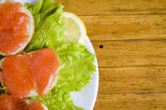Delicious sandwich. Sandwich with smoked fish, lemon slice and luttice stock image