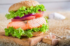 Delicious sandwich with fish and vegetables Royalty Free Stock Photos