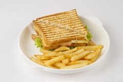 Tasty club Sandwich. Delicious sandwich and fried potatoes Royalty Free Stock Photography