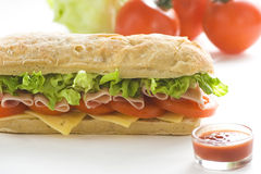 Delicious sandwich of ham cheese lettuce tomato Stock Photos