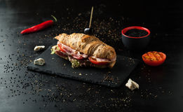 Delicious sandwich with ham, cheese, tomatoes and sesame seeds Stock Photo